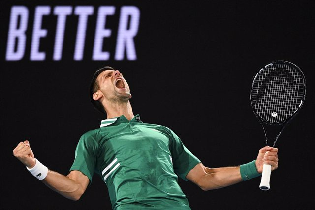 Novak Djokovic of Serbia celebrates after winning his third Round Men's singles match against Taylor Fritz of the United States of America on Day 5 of the Australian Open at Melbourne Park in Melbourne, Friday, February 12, 2021. (AAP Image/Dean Lewins) N