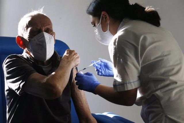 08 February 2021, Italy, Rome: A man receives his dose of the COVID-19 vaccine during a vaccination campaign for people over 80 years of age at the Santa Maria Della Pieta hospital. Photo: Cecilia Fabiano/LaPresse via ZUMA Press/dpa