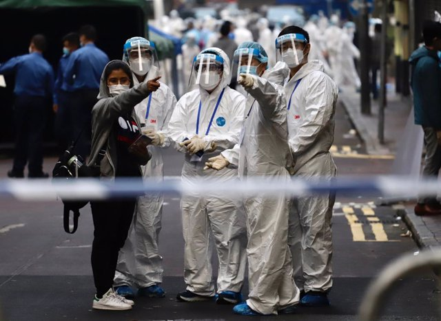 23 January 2021, China, Hong Kong: Sanitizing Team prepare to work in Yau Tsim Mong district where unprecedented lockdown has been declared early this morning by Hong Kong government in order to carry out compulsory coronavirus (Covid-19) testing in the d