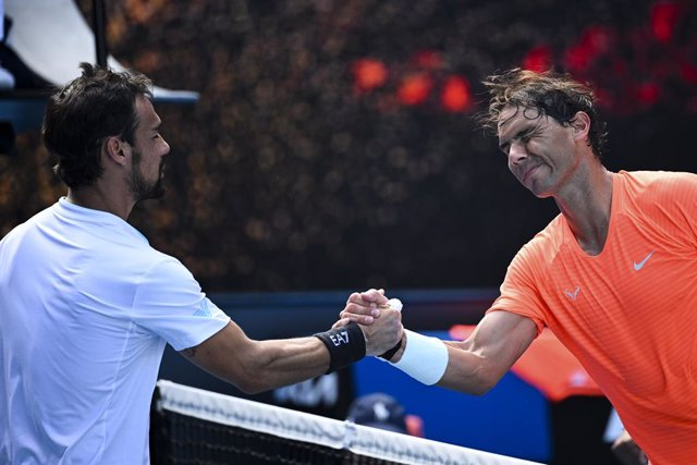 Rafael Nadal of Spain (right) is congratulated by Fabio Fognini of Italy after winning his fourth Round Men's singles match on Day 8 of the Australian Open at Melbourne Park in Melbourne, Monday, February 15, 2021. (AAP Image/Dean Lewins) NO ARCHIVING, ED