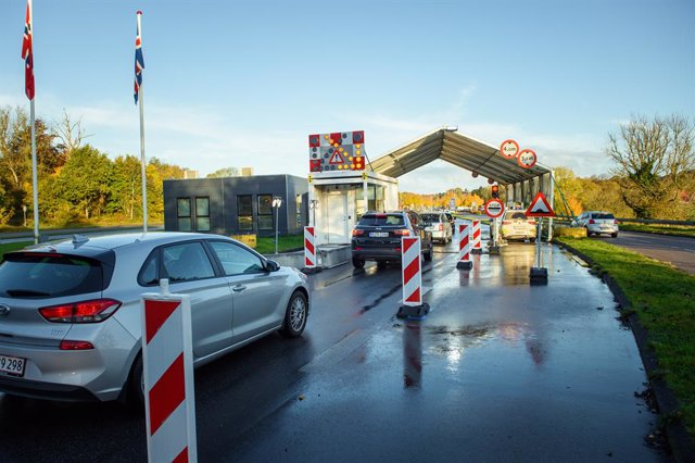 24 October 2020, Schleswig-Holstein, Flensburg: Vehicles drive past the borders near Flensburg from Germany into Denmark. As of Saturday entry from Germany has been subjected to restrictions after Denmark declared Germany as a risk country amid the rising