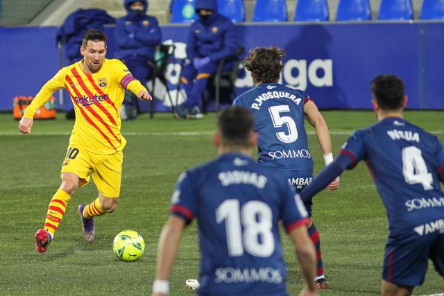 Lionel Messi of FC Barcelona in action during La Liga football match played between SD Huesca and FC Barcelona at El Alcoraz stadium on January 03, 2021 in Huesca, Spain.