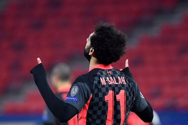 16 February 2021, Hungary, Budapest: Liverpool's Mohamed Salah celebrates scoring his side's first goal during the UEFA Champions League round of 16 first leg soccer match between RB Leipzig and FC Liverpool at Puskas Arena. Photo: Marton Monus/dpa
