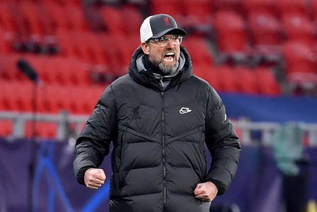 16 February 2021, Hungary, Budapest: Liverpool manager Jurgen Klopp reacts during the UEFA Champions League round of 16 first leg soccer match between RB Leipzig and FC Liverpool at Puskas Arena. Photo: Marton Monus/dpa