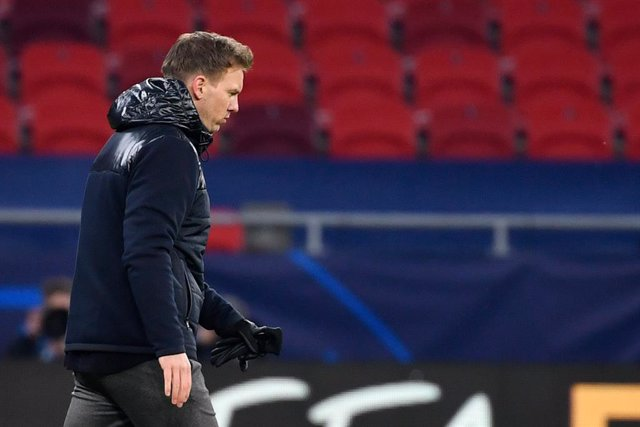 16 February 2021, Hungary, Budapest: Leipzig coach Julian Nagelsmann appears dejected as he leaves the pitch after the UEFA Champions League round of 16 first leg soccer match between RB Leipzig and FC Liverpool at Puskas Arena. Photo: Marton Monus/dpa