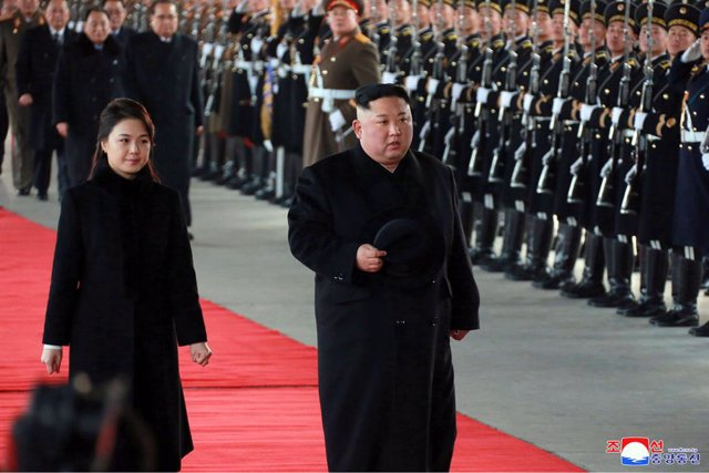 dpatop - HANDOUT - 07 January 2019, North Korea, Pyongyang: A picture provided by North Korea\'s Central News Agency (KCNA) on 08 January 2019 shows North Korean leader Kim Jong Un (R) and his wife Ri Sol-ju departing from Pyongyang on their way to China.
