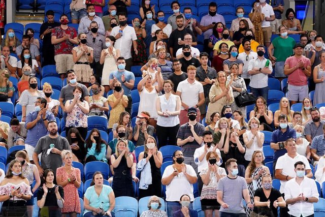 Espectadores presenciando un partido del Abierto de Australia 2021