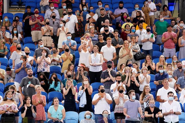 Spectators are seen in the crowd during the second Round Men's singles match between Alex de Minaur of Australia and Pablo Cuevas of Uruguay on Day 4 of the Australian Open at Melbourne Park in Melbourne, Thursday, February 11, 2021. (AAP Image/Dave Hunt)