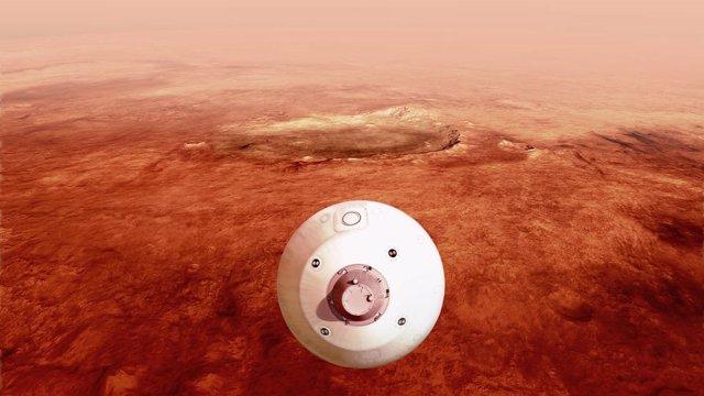 El aerocaparazón que contiene el rover Perseverance de la NASA se guía hacia la superficie marciana a medida que desciende a través de la atmósfera en esta ilustración.