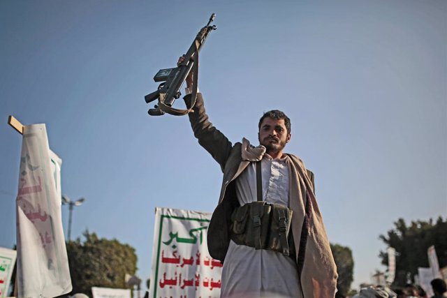 25 January 2021, Yemen, Sanaa: A Houthi supporter holds a weapon as he attends a rally against the United States over its decision to designate the Houthi rebels movement as a foreign terrorist organization. Photo: Hani Al-Ansi/dpa