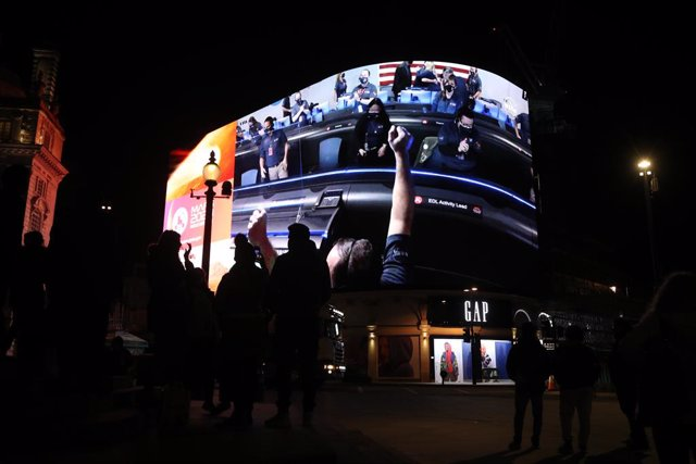 18 February 2021, United Kingdom, London: Images from Nasa of the landing of NASA's Perseverance on Mars is live streamed on Piccadilly Lights in central London.