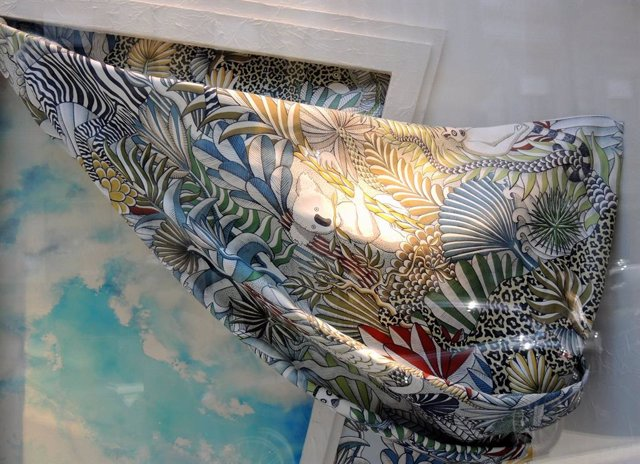 Archivo - April 19, 2019 - Milan, Italy: Hermes scarf. Mid season and summer fashion trend on the shop windows of the Milan fashion district. The Golden quadrilateral, including via Montenapoleone and Via Spiga, is ranked as the sixth most expensive shopp