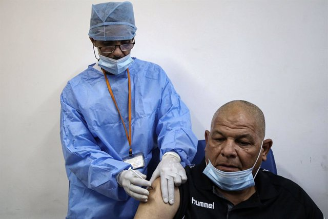 30 January 2021, Algeria, Blida: A man receives a dose of the Russian-made Sputnik V COVID-19 vaccine at a clinic in Blida, a city located nearly 50 kilometres west of capital Algiers, where Algeria launched a national vaccination campaign, starting in a