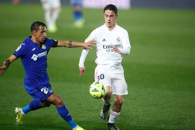 Sergio Arribas of Real Madrid and Damian Suarez of Getafe in action during the spanish league, La Liga Santander, football match played between Real Madrid and Getafe CF at Ciudad Deportiva Real Madrid on february 09, 2021, in Valdebebas, Madrid, Spain.