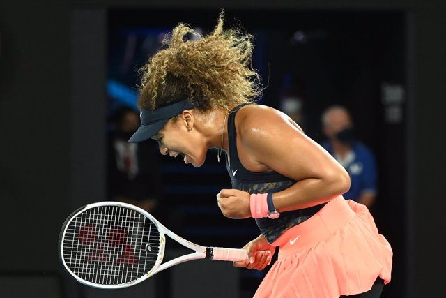 Naomi Osaka of Japan celebrates winning a point in the second set before the women's singles final against Jennifer Brady on day 13 of the Australian Open tennis tournament at Rod Laver Arena in Melbourne,, Saturday, February 20, 2021. (AAP Image/Dave Hun