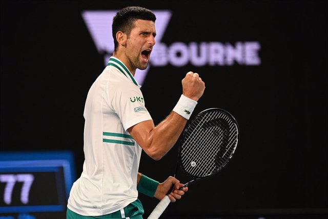 Novak Djokovic of Serbia reacts after defeating Aslan Karatsev of Russia in the Men's singles semifinals match on Day 11 of the Australian Open at Melbourne Park in Melbourne, Thursday, February 18, 2021.(AAP Image/Dean Lewins) NO ARCHIVING, EDITORIAL USE