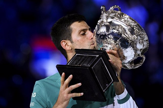 Novak Djokovic of Serbia kisses the Norman Brooks Challenge Cup after winning his Men's singles finals match against Daniil Medvedev of Russia on Day 14 of the Australian Open at Melbourne Park in Melbourne, Sunday, February 21, 2021. (AAP Image/Dean Lewi