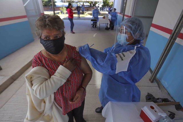 16 February 2021, Mexico, Etzatlan: A woman receives a dose of coronavirus (Covid-19) vaccine during the vaccination campaign for adults over 60 years in the State of Jalisco. Photo: -/El Universal via ZUMA Wire/dpa