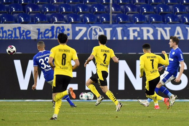 20 February 2021, Gelsenkirchen: Dortmund's Jadon Sancho (2nd R) scores his side's first goal during the German Bundesliga soccer match between FC Schalke 04 and Borussia Dortmund at the Veltins Arena. Photo: Martin Meissner/Pool AP/dpa - IMPORTANT NOTICE