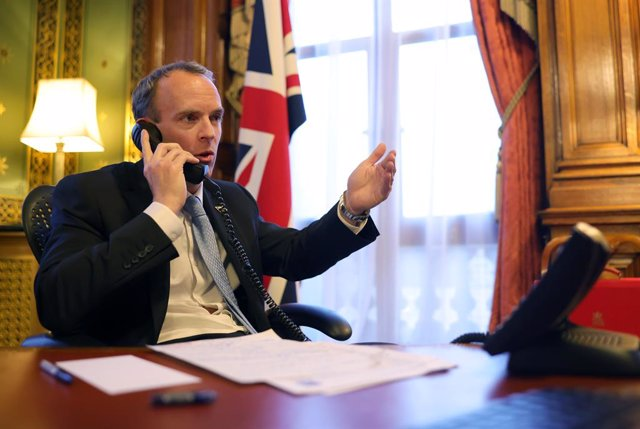 HANDOUT - 27 January 2021, United Kingdom, London: UK Foreign Secretary Dominic Raab makes a phone call with US Secretary of State Antony Blinken. Photo: Pippa Fowles/Downing Street/dpa - ATTENTION: editorial use only and only if the credit mentioned abov