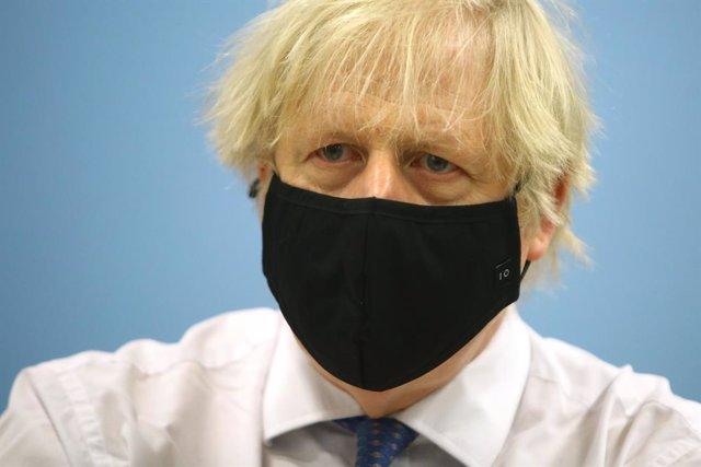 17 February 2021, United Kingdom, Cwmbran: UK Prime Minister Boris Johnson visits a vaccination centre at Cwmbran Stadium. Photo: Geoff Caddick/PA Wire/dpa
