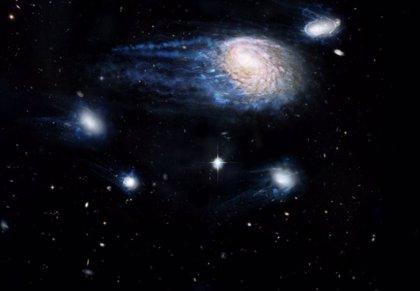 Grandes galaxias roban gas formador de estrellas de sus vecinas enanas