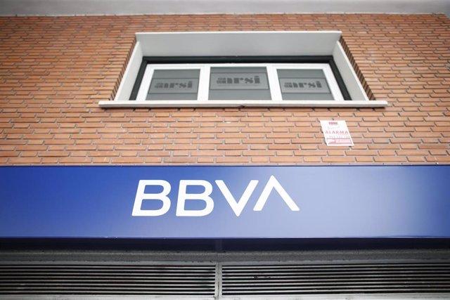 Archivo - Imagen del nuevo logo del BBVA sobre una oficina de la compañía en Madrid.