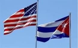 Archivo - Bnaderas de EEUU y Cuba