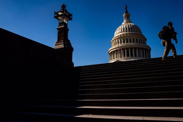 WASHINGTON, DC - FEBRUARY 08: National Guard troops walk up stairs from the Capitol Visitors center with the dome of the U.S. Capitol Building in the background on Monday, Feb. 8, 2021 in Washington, DC. The Senate is scheduled to begin the second impeach