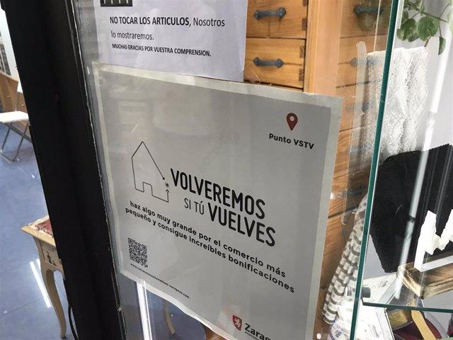 """Archivo - Establecimiento adherido a la campaña """"Volveremos si tu vuelves"""""""