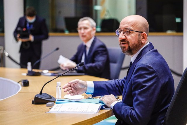 HANDOUT - 26 February 2021, Belgium, Brussels: The European Council President Charles Michel (R) and the North Atlantic Treaty Organization (NATO) Secretary General Jens Stoltenberg attend a video conference with the EU leaders on European security, defen