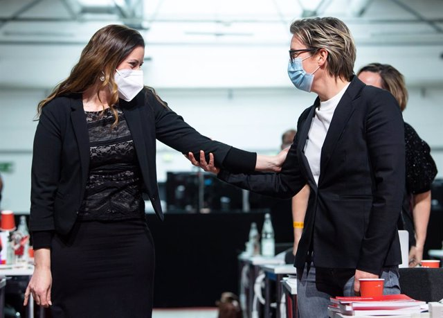 27 February 2021, Berlin: Susanne Hennig-Wellsow (R) and Janine Wissler, congratulate each other on being elected as the new federal co-chairpersons of Die Linke (The Left Party) during the party's online federal conference. A Berlin event hall has been o