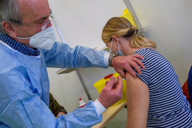 26 February 2021, Saxony-Anhalt, Burg: A health worker vaccinates a teacher with the AstraZeneca COVID-19 vaccine at the Jerichower Land vaccination center. Photo: Klaus-Dietmar Gabbert/dpa-Zentralbild/dpa