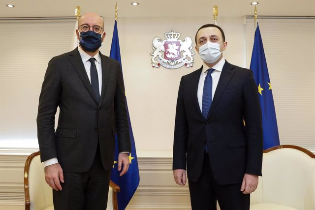 HANDOUT - 01 March 2021, Georgia, Tbilisi: Georgian Prime Minister Irakli Garibashvili (R) and President of the European Council Charles Michel pose for a picture during their meeting. Photo: Dario Pignatelli/European Council/dpa - ATTENTION: editorial us