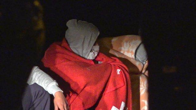 Archivo - Migrante en una patera rescatada en costas canarias