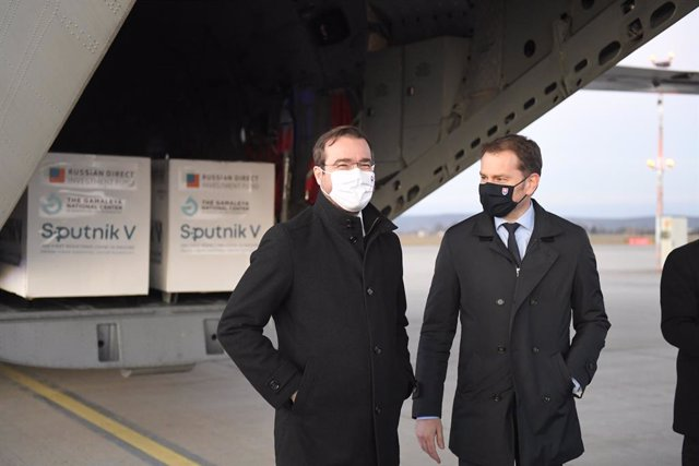 01 March 2021, Slovakia, Kosice: Slovak Prime Minister Igor Matovic (R) and Health Minister Marek Krajci stand in front of an aircraft carrying doses of the Sputnik V's Coronavirus vaccine upon its arrival from Moscow at Kosice International Airport. Phot