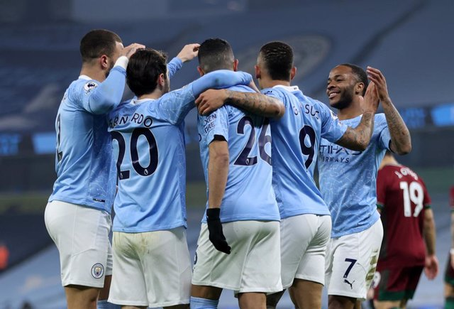 02 March 2021, England, Manchester: Manchester City player celebrate their sides first goal, an own goal by Wolverhampton Wanderers' Leander Dendoncker, during the English Premier League soccer match between Manchester City and Wolverhampton Wanderers at