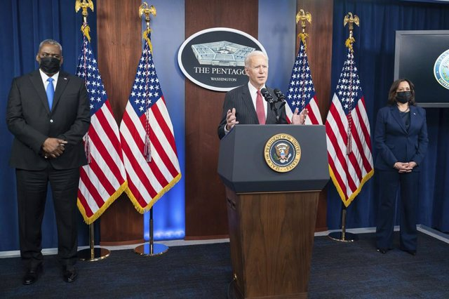 10 February 2021, US, Arlington: US President Joe Biden (C) delivers remarks next to US Vice President Kamala Harris (R) and US Defence Secretary Lloyd Austin at the Briefing Room of the Pentagon. Photo: Adam Schultz/Planet Pix via ZUMA Wire/dpa