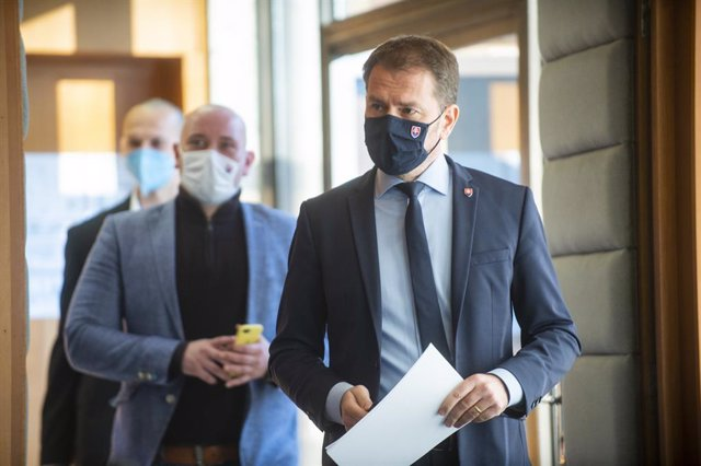 02 March 2021, Slovakia, Bratislava: Slovakian Prime Minister Igor Matovic (R) arrives for a press conference on the purchase of the Russian COVID-19 vaccine Sputnik. Photo: Jakub Kotian/TASR/dpa