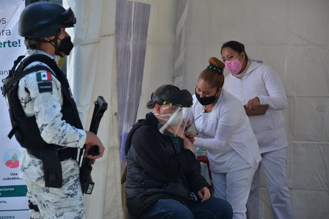 15 February 2021, Mexico, Mexico City: A man receives a dose of AstraZeneca coronavirus (Covid-19) vaccine at the vaccination site in Magdalena Contreras district during the vaccination campaign for adults over 60 years. Photo: Carlos Tischler/eyepix via