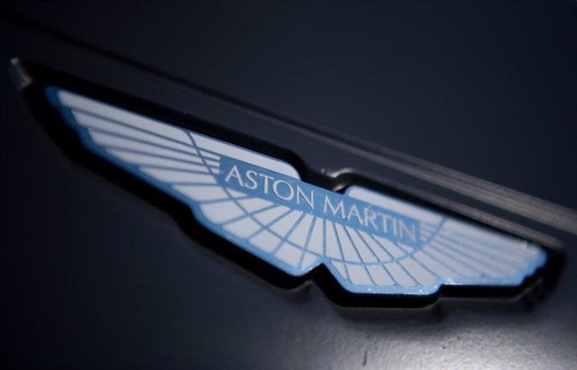 Archivo - FILED - 25 August 2019, Brandenburg, Klettwitz: An Aston Martin logo is seen on the hood of a racing car. Aston Martin reveals its first SUV. Photo: Monika Skolimowska/zb/dpa