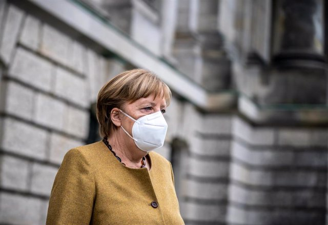 04 March 2021, Berlin: German Chancellor Angela Merkel leaves the Reichstag building after attending a plenary session in the German Bundestag. In its session, the parliament deals with the enacted regulations to contain the Coronavirus pandemic. Photo: M