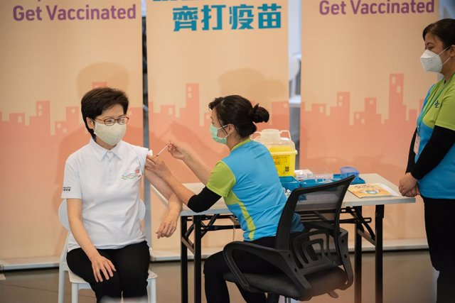 22 February 2021, China, Hong Kong: Hong Kong Chief Executive Carrie Lam (L) receives a dose of a COVID-19 vaccine at the Community Vaccination Centre at the Hong Kong Central Library. Photo: Geovien So/SOPA Images via ZUMA Wire/dpa