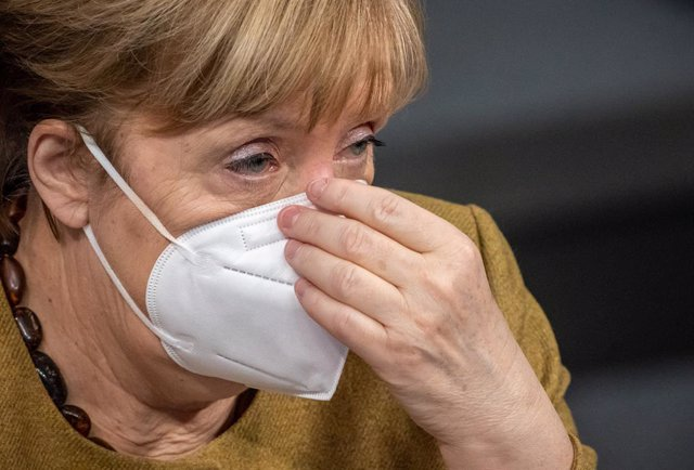 04 March 2021, Berlin: German Chancellor Angela Merkel attends a plenary session in the German Bundestag. In its session, the parliament deals with the enacted regulations to contain the Coronavirus pandemic. Photo: Michael Kappeler/dpa