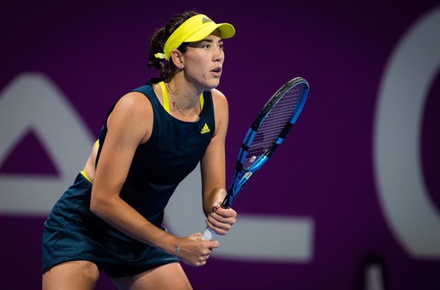 Garbine Muguruza of Spain in action during her second-round match at the 2021 Qatar Total Open WTA 500 tournament against Aryna Sabalenka of Belarus