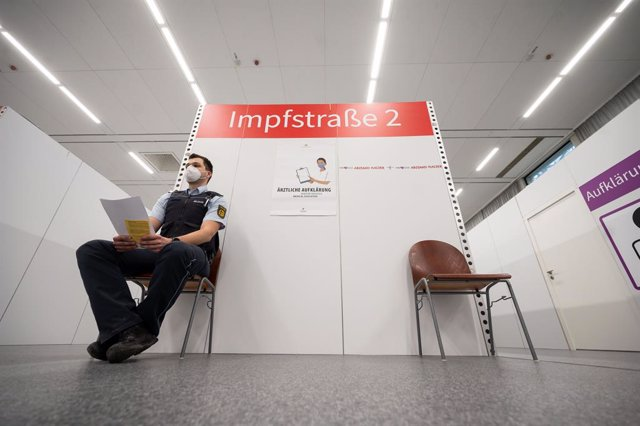 04 March 2021, Baden-Wuerttemberg, Heilbronn: A police officer waits to receive AstraZeneca's Covid-19 vaccine at the district vaccination center. Police officers and law enforcement officers who are exposed to an increased risk of infection while on duty