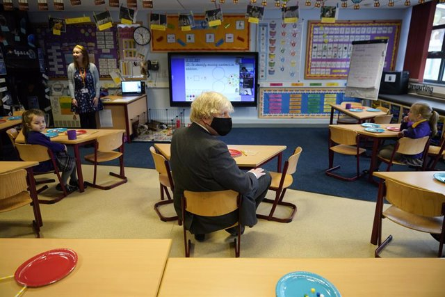 01 March 2021, United Kingdom, Stoke-on-Trent: UK Prime Minister Boris Johnson (C) takes part in a Year 2 maths lesson during a visit to St Mary's CE Primary School to see how they are preparing for students to return. Photo: Christopher Furlong/PA Wire/d