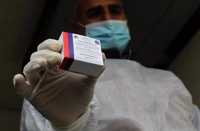 17 February 2021, Palestinian Territories, Rafah: A Palestinian health worker holds a pack of the Sputnik V COVID-19 vaccine. The Gaza Strip received its first batch of the Sputnik V COVID-19 vaccine on Wednesday.