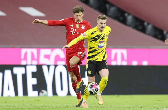Marco Reus of Borussia Dortmund and Leon Goretzka of Bayern Munich during the German championship Bundesliga football match between Bayern Munich and Borussia Dortmund on March 6, 2021 at Allianz Arena in Munich, Germany - Photo Sebastian El-Saqqa / firo