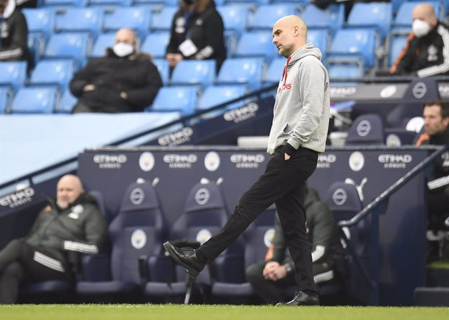 07 March 2021, United Kingdom, Manchester: Manchester City manager Pep Guardiola appears frustrated during the English Premier League soccer match between Manchester City and Manchester United at the Etihad Stadium. Photo: Peter Powell/PA Wire/dpa